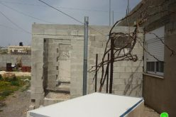 The Israeli Occupation Municipality in Jerusalem forces a Palestinian family to demolish its house