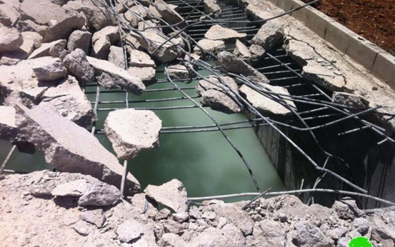 Demolishing a Cistern in Beit Hanina north of Jeruaslem city
