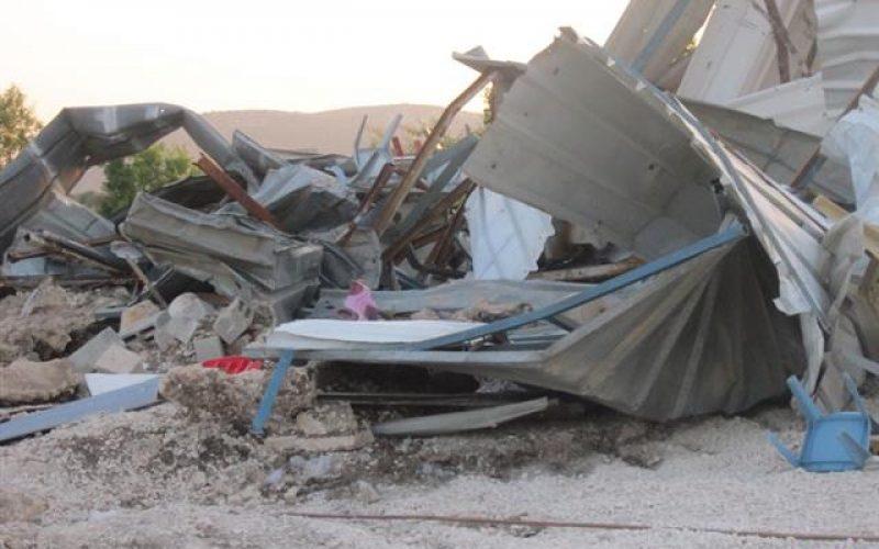 Demolishing a commercial structure in Sabastiya