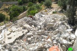 Israeli dozers demolish a residence in Al Mukabber