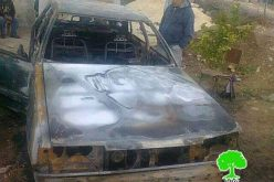 مستمرو دفع الثمن يحرقون سيارة ويخطون شعارات تحريضية على جدران أحد المنازل في قرية جالود