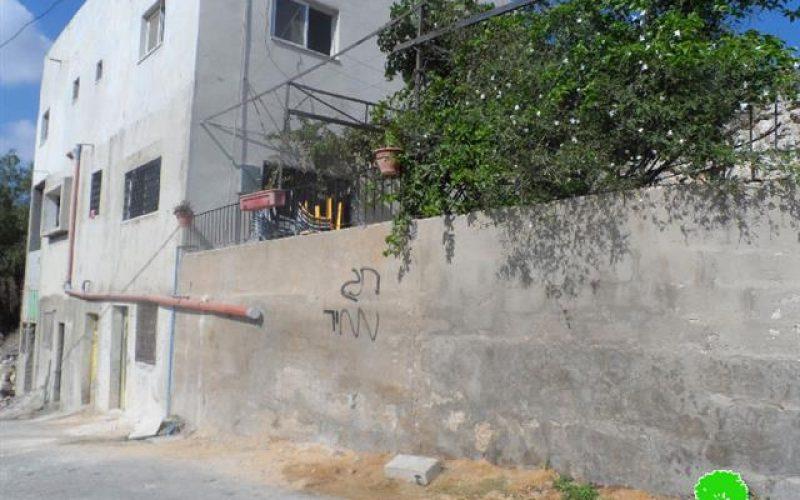 """عصابة """" تدفيع الثمن"""" يحرقون سيارة ويخطون شعارات تحريضية في قرية ياسوف"""