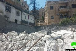 The Israeli occupation municipality demolishes a three story building in the Jerusalem neighborhood of Wad Al-Juz