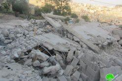 هدم مبنى من ثلاثة طوابق ومسكن آخر في حي واد قدوم في مدينة القدس المحتلة