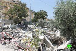 جرافات الاحتلال تهدم مسكناً قيد الإنشاء ومحلين تجاريين في بلدة سلوان