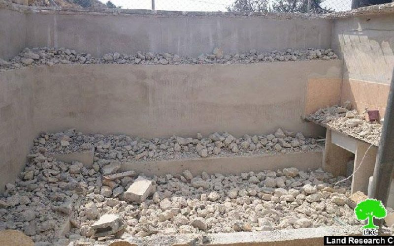 Self-demolition: A crime against humanity<br>  The Israeli occupation forces a Palestinian to self-demolish his agricultural room in the Hebron village of Beit Kahil