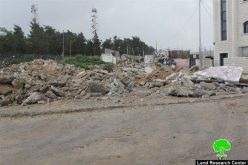 Dozers of Israeli Occupation Forces demolish commercial and residential structures in the Jerusalem town of Beit Hanina
