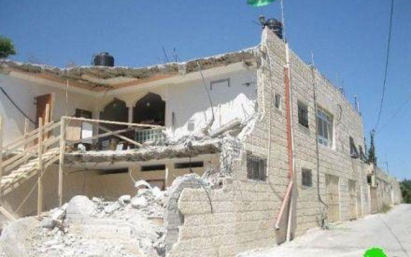 Demolition of four residences in al Mukabber