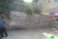 خط شعارات تحريضية على جداران واستهداف 3 مركبات فلسطينية في قريتي رنتيس وبيتللو
