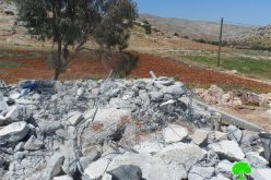 Demolishing a mosque and a number of agricultural and residential structures in Khirbet al Taweel
