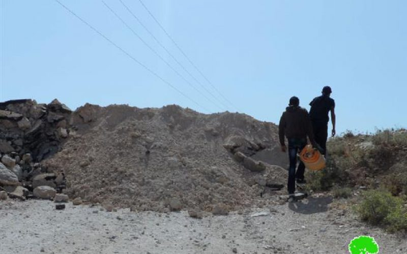 The Israeli occupation ravages a road in Yatta