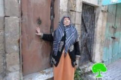 Israeli forces weld shut the doors of an elderly Palestinian woman's house on Shuhada Street