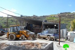 The Israeli occupation demolishes a water cistern and confiscates a caravan in Hebron