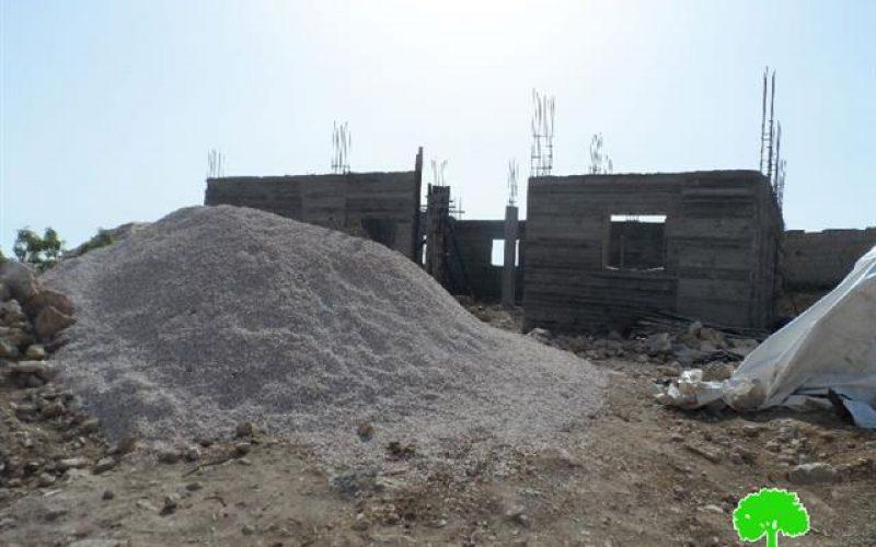 Stop-work order on a residence in al-Dairat village-Yatta