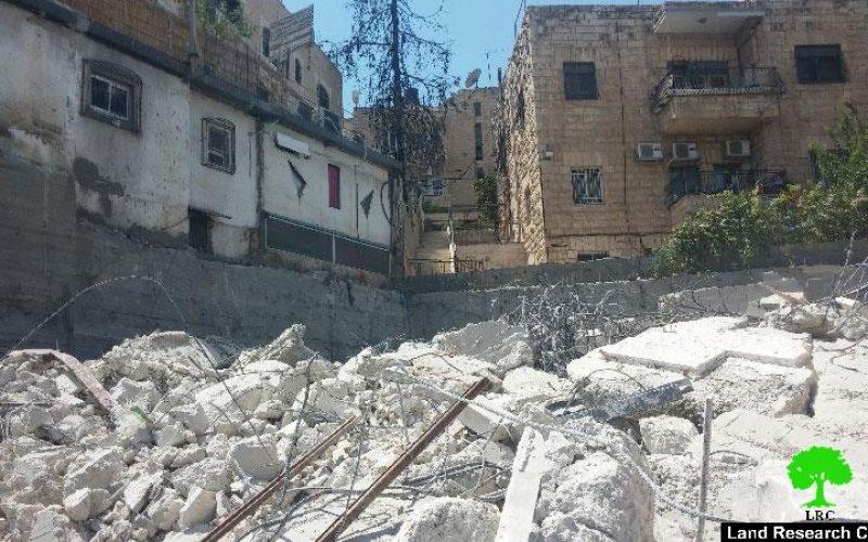 The Israeli occupation municipality demolishes a three story building in the Jerusalem neighborhood of Wad Al-Juz