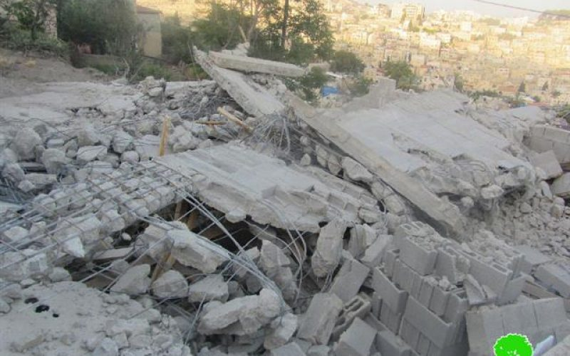 Demolition of a three story building in the Jerusalem neighborhood of Wad Qaddum