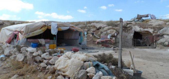 Stop-work order on a residential tent and a cave in the Hebron village Yatta
