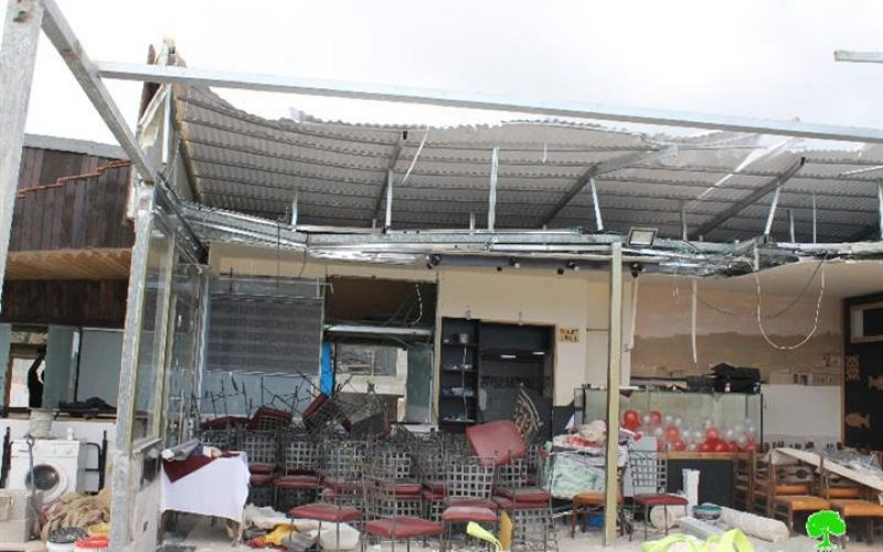 The Israeli Occupation dozers demolish part of a restaurant in Jerusalem