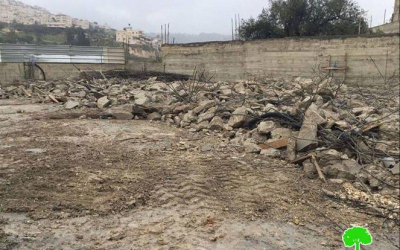 The occupation dozers demolish an under construction residence in the Jerusalem Wad Qaddum neighborhood