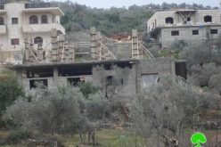 The Israeli Occupation Forces notify two Nablus residences of stop-work