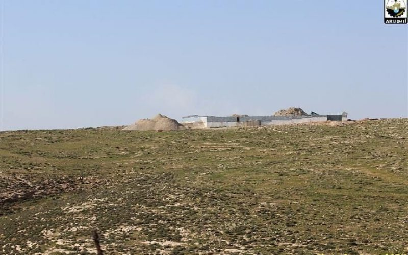 Israeli settlers construct a new bypass road on lands of Kisan village