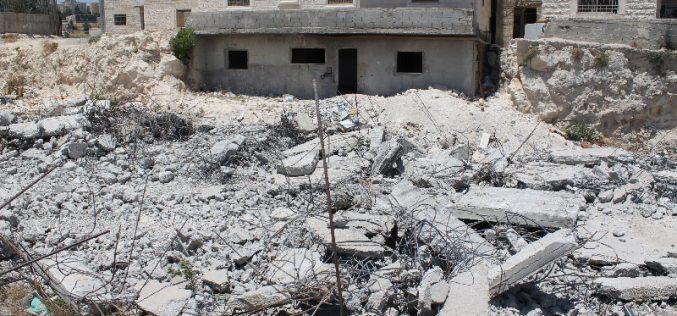 Dozers of Israeli municipality in Jerusalem demolish a house in the Al-Isawiya town