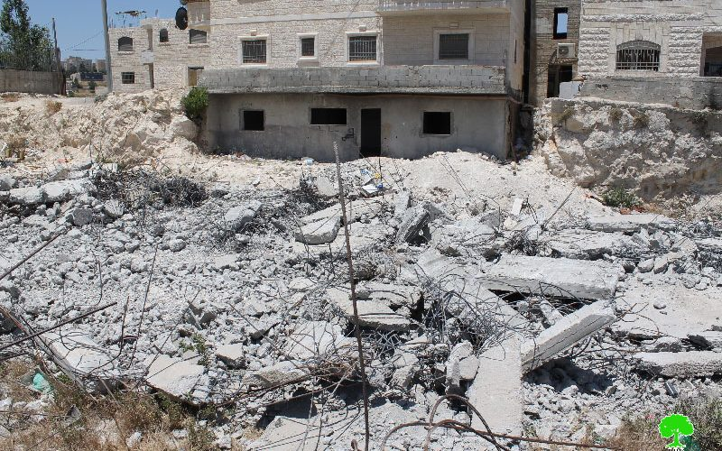 Dozers of Israeli municipality in Jerusalem demolish a house in the Al-Isawiya town