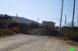 الاحتلال الإسرائيلي يغلق طريقين رئيسيين جنوب بلدة حوارة بالسواتر الترابية
