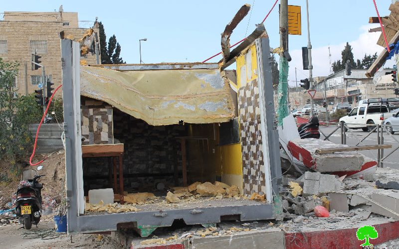 Dozers of Israel Municipality demolish a container used as food truck in Jerusalem