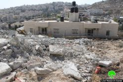 Demolishing an under construction building in the neighborhood of Beit Hanina north of Jerusalem
