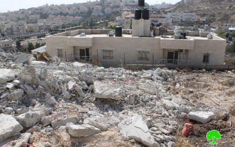 Demolishing an under construction building in the neighborhood of Beit Hanina north of Jerusalem