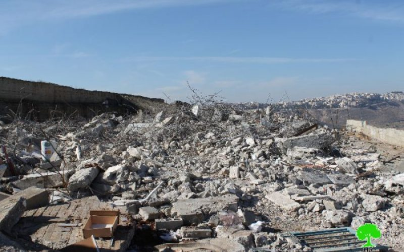 Dozers of Israel Municipality demolish a residential building in Shuafat, north of Jerusalem