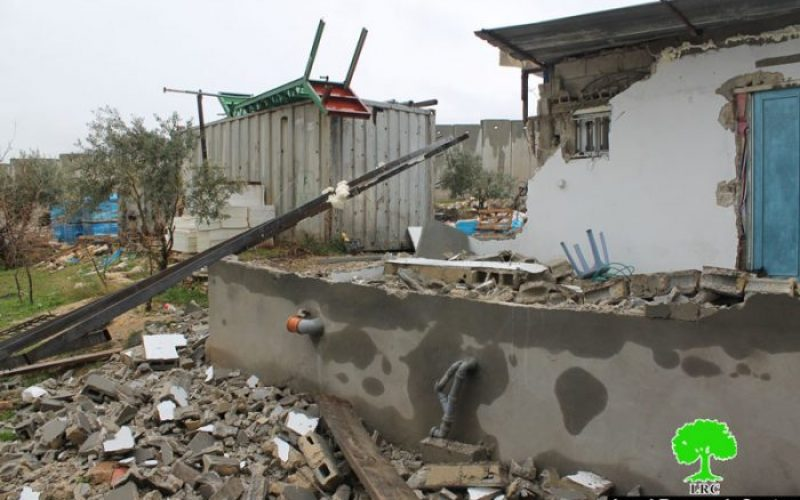 Israeli dozers demolish part of a residence in the Jerusalem village of Hizma