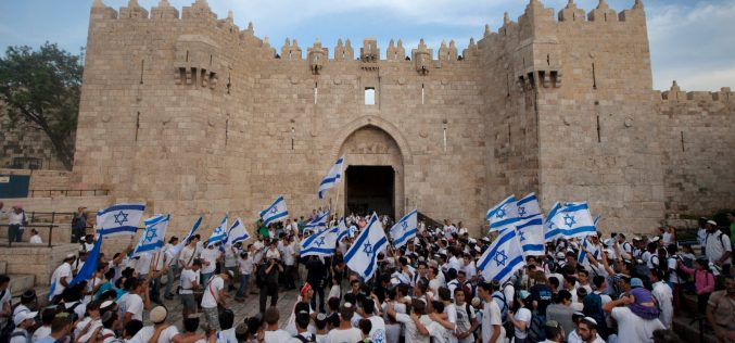 Israeli colonists march in Jerusalem to celebrate the fiftieth anniversary of occupation