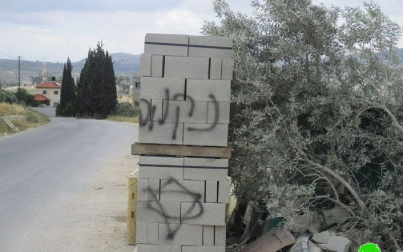 Price Tag colonists torch a dozer and write hatred inciting slogans in Nablus city