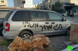 Israeli colonist slash tires of Jerusalemite cars and write  insults against Prophet Mohammad (PBUH) in Shu'fat village in Jerusalem