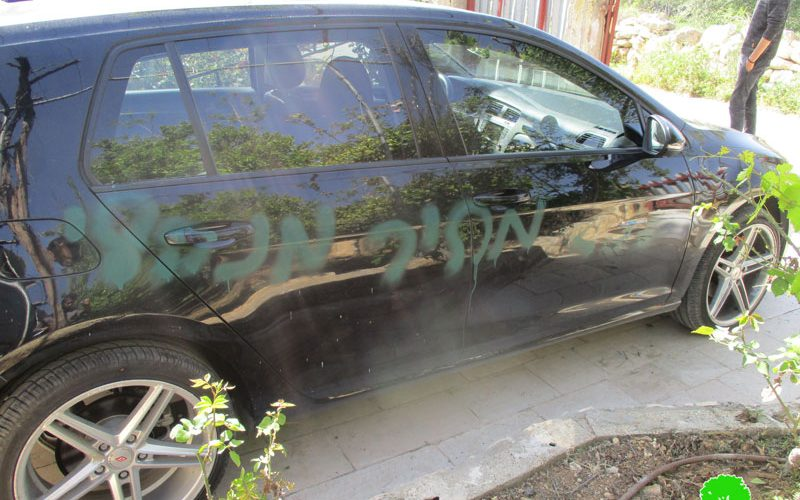 Israeli colonists write racist graffiti and slash cars' tires in Qalqiliya