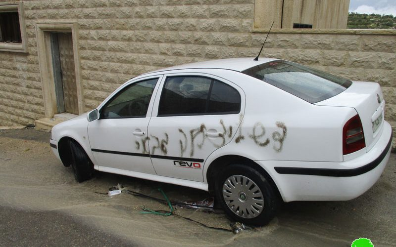 Israeli colonists paint Anti-Arab graffiti on several cars in Jit village in the West Bank.