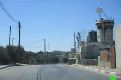 Setting up a metal gate on Kafr Na'ama entrance / Ramallah governorate