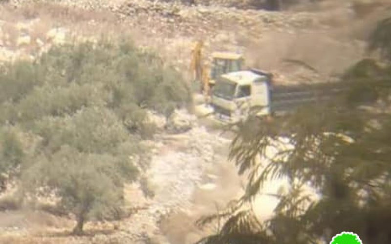 Confiscating a bulldozer and a truck in Kafr Qadoum village/ Qalqilya governorate