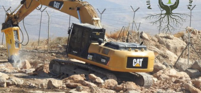 Settlers open a new bypass road east Yatta/ Hebron Governorate