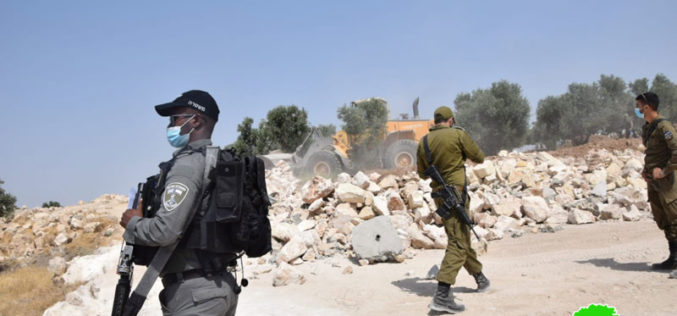 The Israeli Civil Administration demolishes retaining walls in Zif area South Hebron