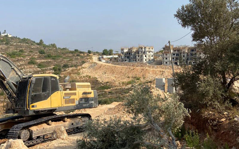 The Israeli Occupation machineries uproot 22 olive trees in Ras Karkar village / Ramallah governorate